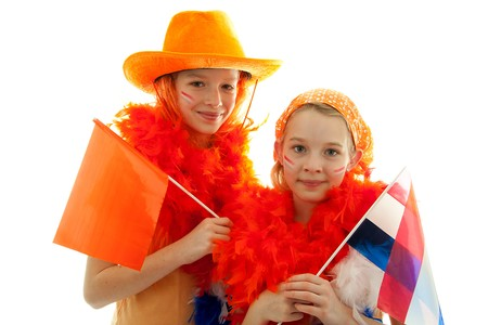 Two girls posing in orange outfit for soccer game or Dutch Queensday over white background Stock Photo - 7052200