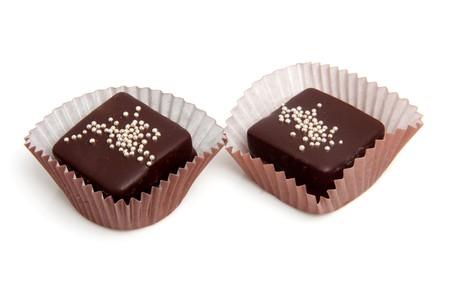 petit: delicious chocolate petit four over white background