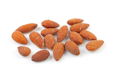unpeeled: unpeeled almond nuts isolated on white background Stock Photo