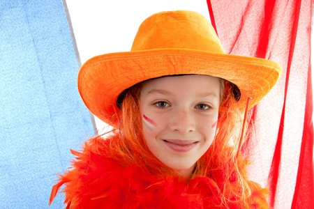 Young Dutch soccer supporter in orange outfit against the Netherlands flag photo