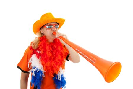 Female Dutch soccer supporter with orange plastic vuvuzela over white background Stock Photo - 7280420