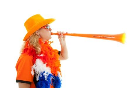Female Dutch soccer supporter with orange plastic vuvuzela over white background Stock Photo - 7280419