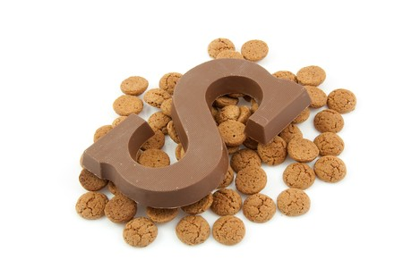Chocolate letter S and ginger nuts for Sinterklaas, event in the Dutch in december, over white background