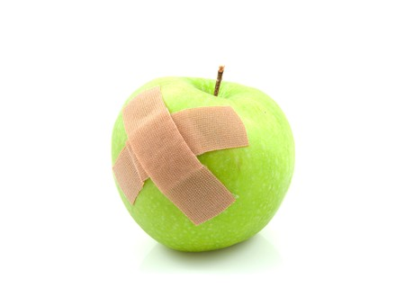 nursing sister: sick green apple with patches over white background
