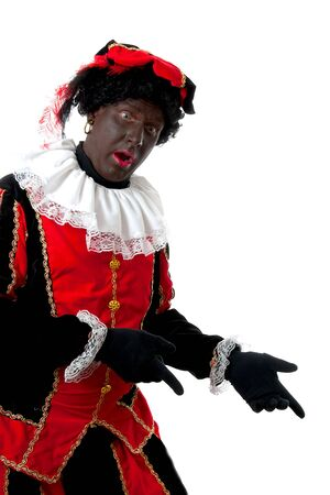 saint nicolaas: surprised Zwarte piet ( black pete) typical Dutch character part of a traditional event celebrating the birthday of  Sinterklaas in december over white background is pointing