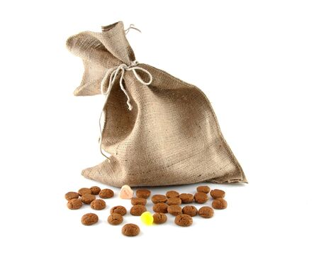 gingernuts: jute bag with ginger nuts over white background