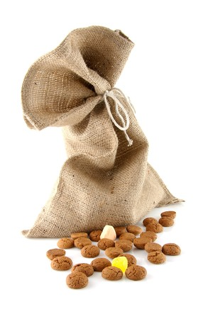 ginger nuts: jute bag with ginger nuts over white background