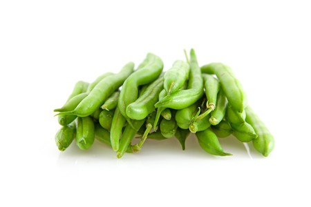 long bean: pile of raw long green beans over white background