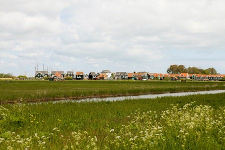 Landscape with typical Dutch houses in the village Marken photo
