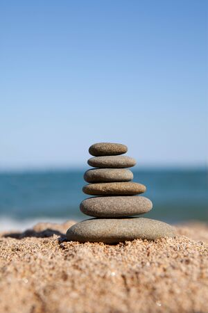 stack of stones near the ocean photo