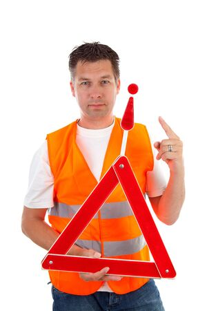 Man in safety vest holding foldaway reflective road hazard warning triangle over white background photo