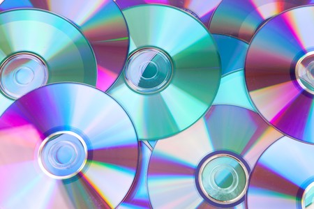 discs: background made out of compact discs CDs in closeup