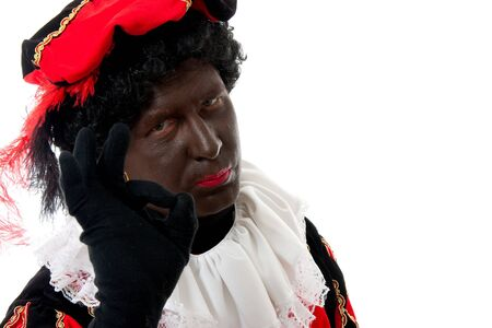 black pete: Zwarte piet ( black pete) typical Dutch character part of a traditional event celebrating the birthday of Sinterklaas in december over white background making OK sign Stock Photo