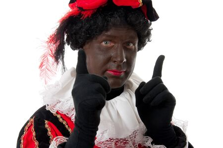 Zwarte piet ( black pete) typical Dutch character part of a traditional event celebrating the birthday of Sinterklaas in december over white background Stock Photo - 7777416
