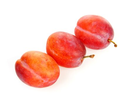 laxatives: couple of plums in closeup over white background