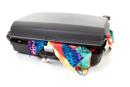 stuffed suitcase for vacation over white background