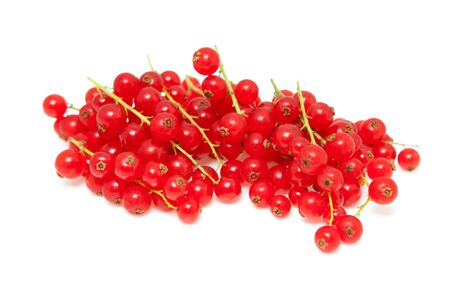 bacca: pile berries of red currant in closeup over white background Stock Photo