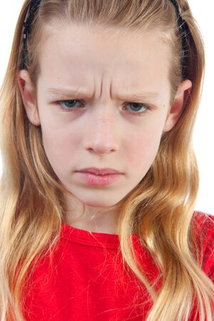 girl is angry, portrait in closeup, over white background Stock Photo - 7960942