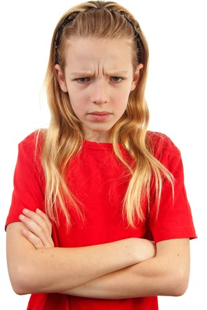 child stress: portrait of angry girl standing over white background