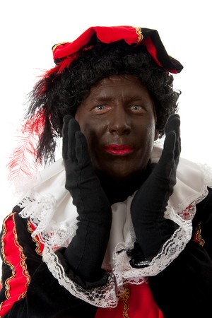 surprised Zwarte piet ( black pete) typical Dutch character part of a traditional event celebrating the birthday of  Sinterklaas in december over white background Stock Photo - 8104629
