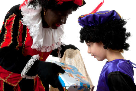 Zwarte piet ( black pete) typical Dutch character part of a traditional event celebrating the birthday of  Sinterklaas in december over white background with young child Stock Photo - 8104627