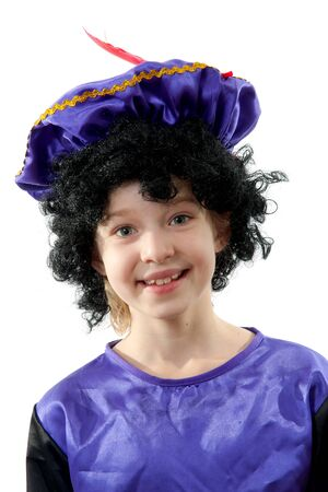 black pete: Little girl dresses as black pete (zwarte piet), typical Dutch character part of traditional event celebrating the birthday of  Sinterklaas in december over white background