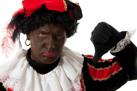 nicolaas: Zwarte piet ( black pete) typical Dutch character part of a traditional event celebrating the birthday of  Sinterklaas in december over white background with thumbs down