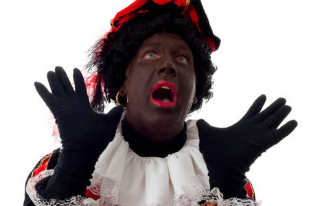surprised Zwarte piet ( black pete) typical Dutch character part of a traditional event celebrating the birthday of  Sinterklaas in december over white background Stock Photo - 8104609