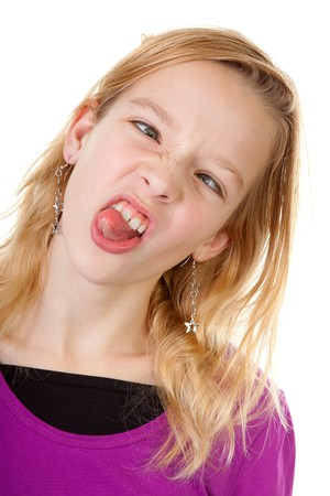 goofy: young girl makes funny face in closeup over white background