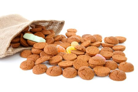 bag with typical dutch sweets: pepernoten (ginger nuts) for a celebration at 5 december in the Netherlands over white background Stock Photo - 8104614