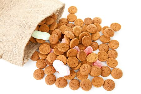 bag with typical dutch sweets: pepernoten (ginger nuts) for a celebration at 5 december in the Netherlands over white background Stock Photo - 8104623