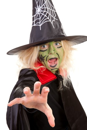 Scary green witches for Halloween with focus on hand, face blur over white background Stock Photo - 8179232