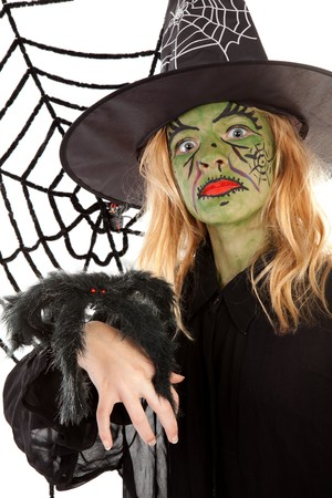 Scary green witches for Halloween with spiderweb over white background photo