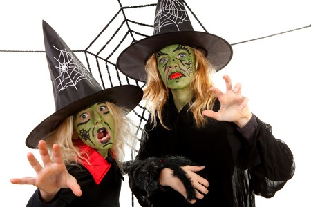 Scary green witches for Halloween with spiderweb over white background Stock Photo