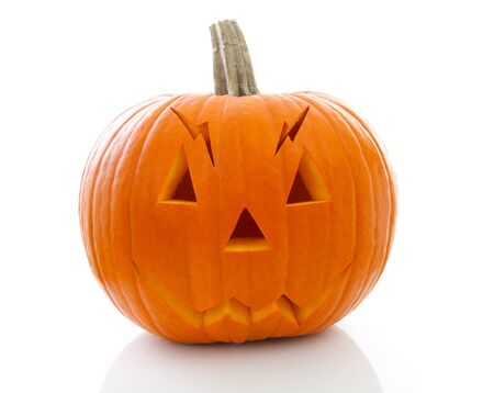 scary halloween pumpkin with face isolated on white background photo