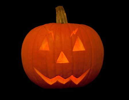 scary halloween pumpkin with face isolated on black background Stock Photo - 8225591