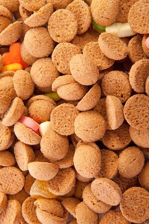 background of typical dutch sweets: pepernoten (ginger nuts) for a celebration at 5 december in the Netherlands photo