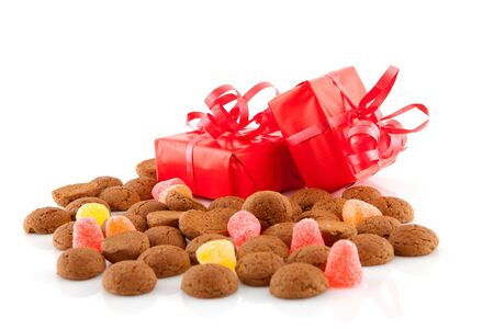 Typical dutch sweets: pepernoten (ginger nuts) and presents for celebration at 5 december in the Netherlands Stock Photo - 8409466
