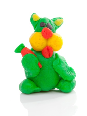 clay modeling: green bunny clay modeling over white background