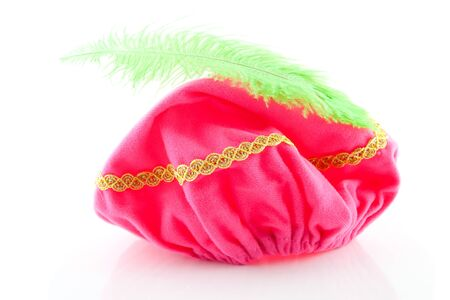 pieten: pink hat with green feather of Zwarte Piet, typical Dutch event in december, isolated on white background Stock Photo