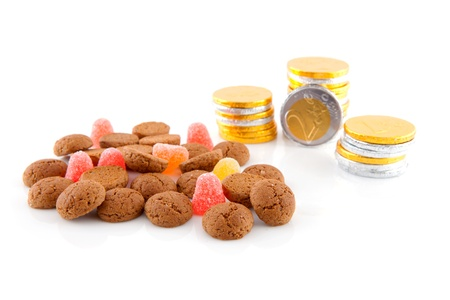 pepernoten: Typical dutch sweets: pepernoten (ginger nuts) and chocolate money for a celebration at 5 december in the Netherlands over white background Stock Photo