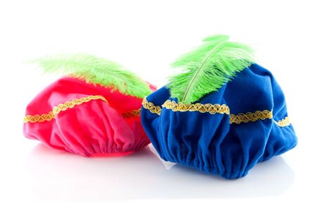 zwarte: pink and blue hat with green feather of Zwarte Piet isolated on white background