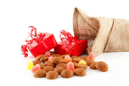 Typical Dutch celebration: Sinterklaas with surprises in bag and ginger nuts, ready for the kids in december. Isolated on white background photo