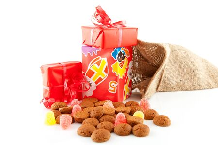 Typical Dutch celebration: Sinterklaas with surprises in bag and ginger nuts, ready for the kids in december. Isolated on white background Stock Photo - 8409585