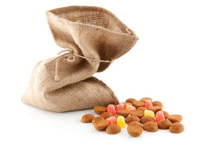 '5 december': bag with typical dutch sweets: pepernoten (ginger nuts) for a celebration at 5 december in the Netherlands over white background   Stock Photo