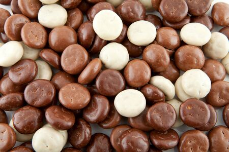 gingernuts: background of chocolate gingernuts, pepernoten, in closeup. Tyical Dutch candy for 5 december.