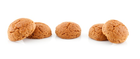 ginger nuts: Couple of  pepernoten (ginger nuts) sweets for typical Dutch festivity at 5 december over white background