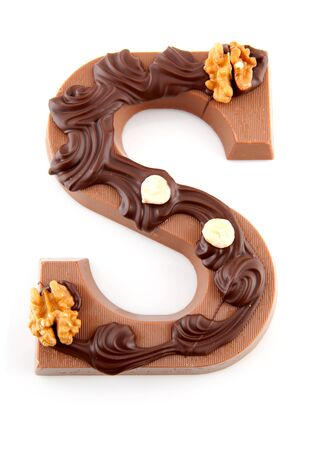 Decorated Chocolate letter S for Sinterklaas, typical Dutch party in december, isolated on white background Stock Photo - 8409515