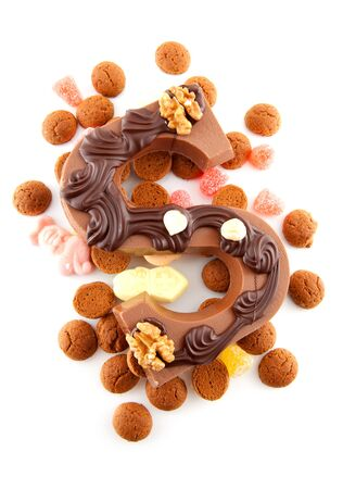 Decorated Chocolate letter S for Sinterklaas with ginger nuts, typical Dutch party in december, isolated on white background Stock Photo - 8409602