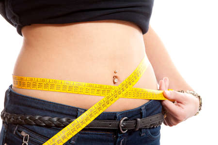 diet, young woman is measuring her waist in closeup over white background Stock Photo - 8409679